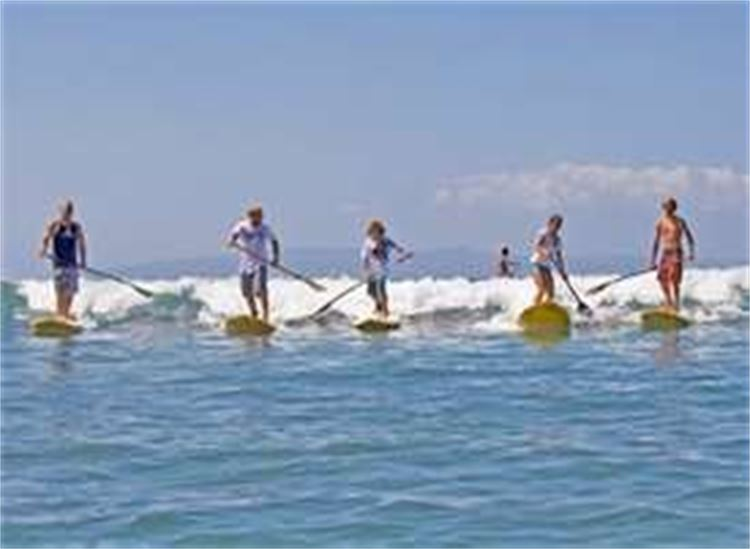Group of people on Stand Up Paddleboards
