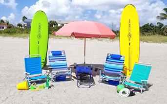 Beach gear with surfboards for the whole family