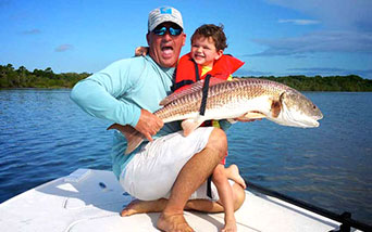 Father and son with large Red Drum Fish