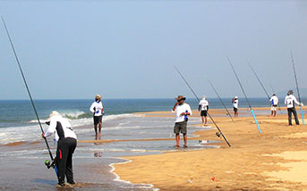 people fishing from the beach